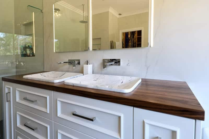 Custom Bathroom Cabinetry in collaboration with Divine Renovations including Vanity Unit with the Black Walnut timber, White Marble Basin and White Panel Cabinetry.
