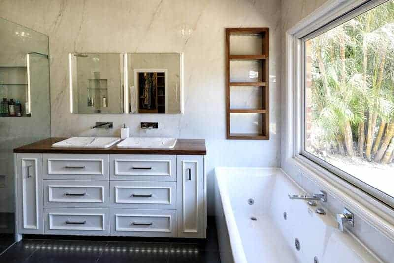 Custom Bathroom Cabinetry in collaboration with Divine Renovations - Vanity Unit with the Black Walnut timber, White Marble Basin and White Panel Cabinetry.