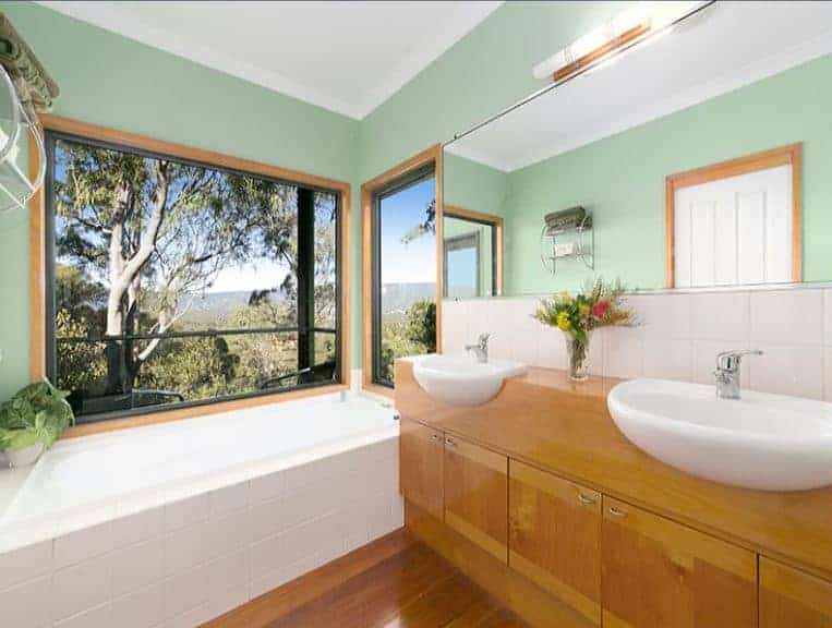 Bathroom Vanity in Blackbutt Timber. The two bathroom vanities have been made to match the timber architraves, in solid Blackbutt timber. Check out that view from the bath!