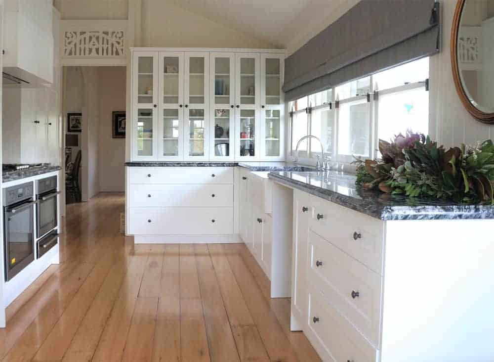We built this matte white kitchen to compliment this charming Queenslander style home in Brisbane. We also designed and built a custom cabinet, painted white with American Oak timber shelves for the formal living room.